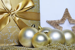 Christmas decoration. Christmas background with present and christmas bulbs Stock Photography