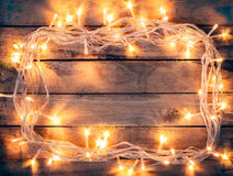 Christmas decoration background - vintage planked wood with ligh Stock Photos