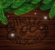 Christmas decoration on the background of the wooden planks. Christmas tree branch, bright multi-colored lights on a bright wooden. Background. Poster for the Royalty Free Stock Photography