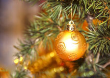 Christmas decoration ball. Close-up on gold background Royalty Free Stock Photos