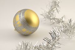 Christmas decoration ball. Golden and silver Christmas ball decoration soft white background Royalty Free Stock Photography