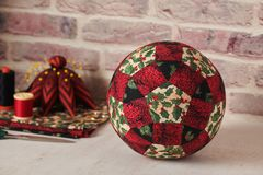 Free Christmas Decoration Ball Sewn From Pieces Of Fabrics, Sewing Accessories, Traditional Patchwork Stock Image - 155899031