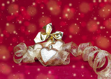 Christmas decoration- ball in shape a heart with ribbon Stock Photography