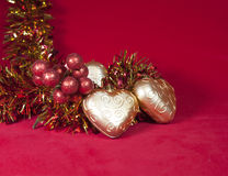 Christmas decoration- ball in shape a heart with ribbon Stock Images