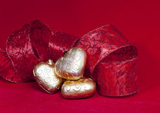 Christmas decoration- ball in shape a heart with ribbon Royalty Free Stock Image