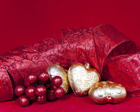 Christmas decoration- ball in shape a heart with ribbon Stock Image
