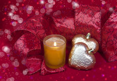 Christmas decoration- ball in shape a heart with ribbon and a candle Royalty Free Stock Images