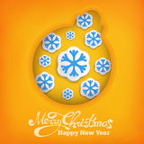 Christmas decoration ball siymbol with snowflakes on warm yellow background Royalty Free Stock Image