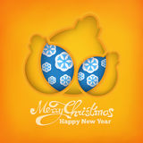 Christmas decoration ball siymbol with snowflakes on warm yellow background Stock Images