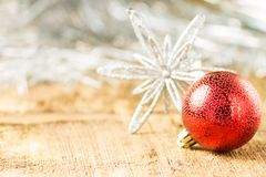 Christmas decoration. Ball with Snowflake on board Royalty Free Stock Photo