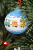Christmas decoration - ball with train. Christmas decoration - hand-made ball with train on christmas tree Stock Photos