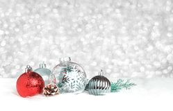 Christmas decoration ball on white fur at silver bokeh light bac stock images