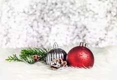 Christmas decoration ball on white fur at silver bokeh light bac royalty free stock photo