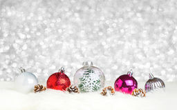 Christmas decoration ball on white fur at silver bokeh light bac Royalty Free Stock Photography