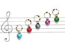 Christmas decoration balls are arranged on a piece of paper like music notes. Christmas melody concept stock images