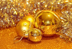 Christmas decoration balls. Close-up on gold background Stock Image