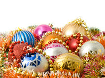 Christmas decoration - balls and colorful tinsel Stock Photos