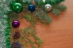 Christmas Decoration. Balls and cones on wooden table royalty free stock image
