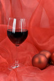 Christmas decoration with balls, and glass of red Stock Photography