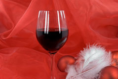 Christmas decoration with balls, and glass of red Royalty Free Stock Photo