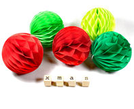 Christmas decoration balls in green and red with wooden stamps Royalty Free Stock Photo
