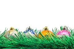 Christmas decoration balls and green tinsel Royalty Free Stock Photos