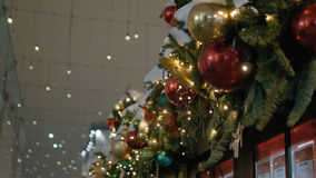 Christmas decoration balls hanging on tree on the background lights garland. Holiday City Lights stock footage