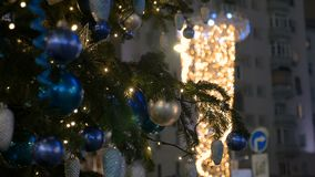 Christmas decoration balls hanging on tree on the background lights garland. Holiday City Lights stock video