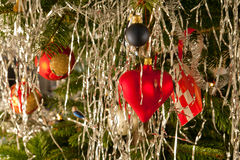 Christmas decoration balls and hearts on a tree Stock Photos