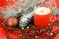 Christmas decoration with balls and lighted candle Royalty Free Stock Photo