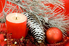 Christmas decoration with balls and lighted candle Royalty Free Stock Image