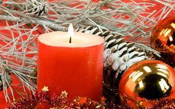 Christmas decoration with balls and lighted candle Stock Photography