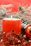 Christmas decoration with balls and lighted candle Stock Photos