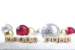 Christmas decoration balls and Merry Christmas text Stock Photo