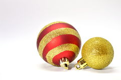 Christmas decoration - Balls red and golden. Christmas decoration - Decorative red and golden balls on a white background Royalty Free Stock Photos