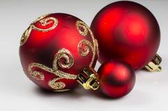 Christmas decoration - 3 balls. Christmas decoration of three red balls on light background Royalty Free Stock Photo
