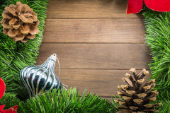 Christmas decoration with bauble on wooden background Royalty Free Stock Photography