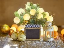 Christmas decoration with baubles, lantern and empty board Stock Images