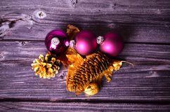 Christmas decoration. With baubles and pine cones in front of a wooden background Stock Photography