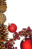 Christmas Decoration with Baubles, Pine Cones and a Winterberry Wreath Royalty Free Stock Images