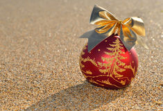 Christmas decoration on a beach sand  Royalty Free Stock Photo