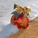 Christmas decoration on beach sand Royalty Free Stock Photos