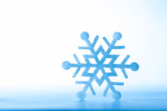 Christmas decoration. Beautiful snowflake on real snow outdoors. Royalty Free Stock Photo