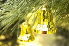Christmas decoration bell close-up. On pine Stock Image