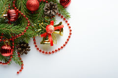 Christmas decoration bell, pine cones and branch Royalty Free Stock Photos