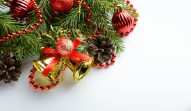 Christmas decoration bell, pine cones and branch Stock Photos