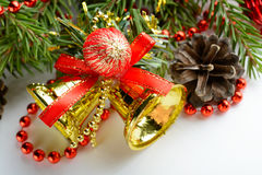 Christmas decoration bell, pine cones and branch Royalty Free Stock Images