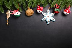 Christmas fir branches with decorations on a black background Stock Images