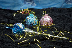Christmas decoration on black velvet with a blue backdrop Royalty Free Stock Image