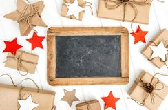 Christmas decoration blackboard wrapped gifts Stock Image